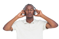 Man with eyes closed listening to music stock photos