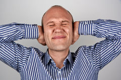 Man with eyes and ears tightly closed Stock Images