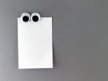 Man eyes fridge magnet and blank note for text input Royalty Free Stock Images