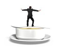 Man för bakre sikt som balanserar på skeden med soppabunken Royaltyfri Bild