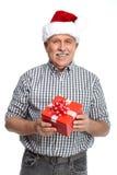 Man för lycklig jul med xmas-gåvan. Fotografering för Bildbyråer