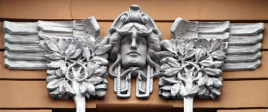 Man face. Ornament on the wall in Gertrudes street Royalty Free Stock Photography
