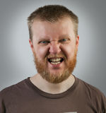 Man on the face of aggression. Redbeard man on the face of aggression Royalty Free Stock Photography