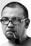 Man face with beard and glasses and smoking pipe Stock Images