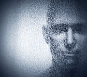 Man face blended with binary code digits. Concept of hacker, data protection etc. Royalty Free Stock Image