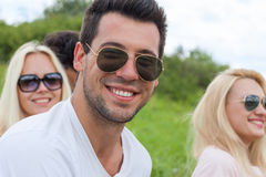 Man face close up outdoor green grass, People sunglasses happy smile Royalty Free Stock Image