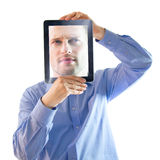 Man and Face Computer Tablet. Man holding digital display computer tablet with face on screen Stock Photo