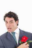 Man with face expression holding with his hand rose Royalty Free Stock Photo