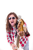 Man with face expression pointed his  guitar at the camera Royalty Free Stock Photos