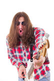 Man with face expression in shirt playing electric bass guitar Royalty Free Stock Images