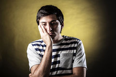 Man face expressions. Young man with expression of fatigue and boredom Royalty Free Stock Photos