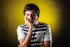 Man face expressions. Young man with expression of fatigue and boredom Royalty Free Stock Image