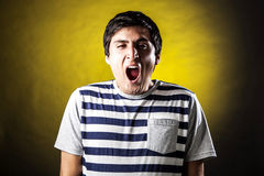 Man face expressions. Young man with expression of fatigue and boredom Stock Image