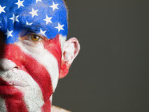 Man face flag of USA, sad expression Royalty Free Stock Photo