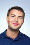 Man with face full of lipstick marks of kisses Royalty Free Stock Photography
