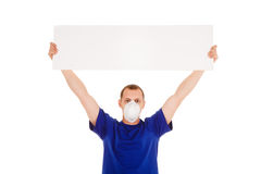 Man in face-guard mask with blanc poster isolated in white backg Royalty Free Stock Image