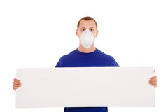 Man in face-guard mask with blanc poster isolated Royalty Free Stock Photo
