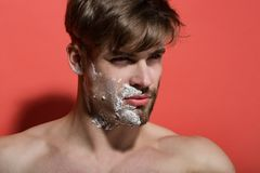 Man face half shaved and bearded with shaving cream. On red background. Morning hygiene concept. Skincare, beauty, grooming stock photos