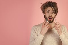 Man face handsome. Morning, hair care, everyday life. Man with disheveled hair grooming in morning. Barber and hairdresser, male fashion. Man trimming beard Stock Photo