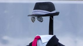A man without face. Hat, Sunglasses and suit royalty free stock photos