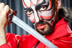 Man with face mask. And sword Royalty Free Stock Photos