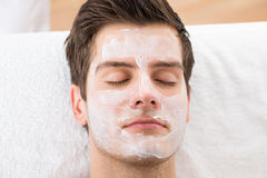 Man With Face Mask. Face Mask Applied To A Young Man In A Spa royalty free stock images