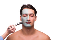 The man with face mask being applied on white Stock Images