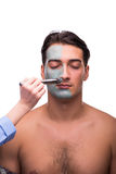 The man with face mask being applied on white Stock Photo