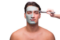The man with face mask being applied on white Stock Photos