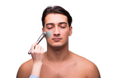 The man with face mask being applied on white Royalty Free Stock Photography