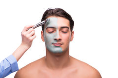 The man with face mask being applied on white Stock Image