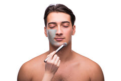 The man with face mask being applied on white Royalty Free Stock Image