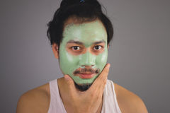 Man with face mask skincare. Stock Photo