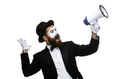 Man with a face mime screaming into megaphone. Man  with a face mime screaming into a megaphone, isolated on white background. concept of effective communication Stock Photos