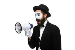 Man with a face mime screaming into megaphone. Man  with a face mime screaming into a megaphone, isolated on white background. concept of effective communication Royalty Free Stock Photos