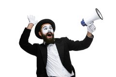 Man with a face mime screaming into megaphone. Man  with a face mime screaming into a megaphone, isolated on white background. concept of effective communication Royalty Free Stock Photography