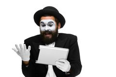 Man with a face mime working on laptop Royalty Free Stock Image