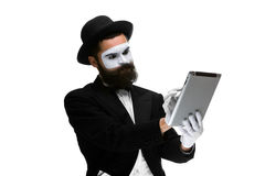 Man with a face mime working on  laptop Royalty Free Stock Photography
