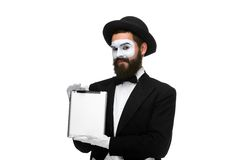 Man with a face mime working on  laptop Royalty Free Stock Photo