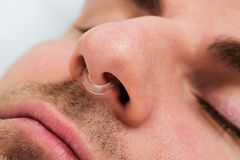 Man face with nose clip device. Extreme Close-up Of Man Face With Nose Clip Device Royalty Free Stock Photography