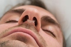 Man face with nose clip device Royalty Free Stock Photo