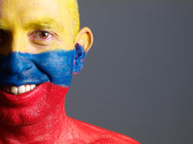 Man face painted with colombian flag, smiling expression Stock Photos