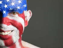 Man face painted with the flag of USA. Royalty Free Stock Images