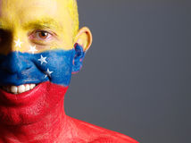 Man face painted with venezuelan flag, smiling expression Royalty Free Stock Photos