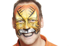 Man with face painting tiger Stock Image