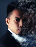 Man face with pixel dispersion effect. Over a gray background stock image