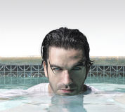 Man face in pool Stock Photography