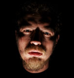 Man face with small sores. In black Stock Photos