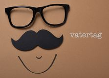 Man face and text vatertag, fathers day in german Royalty Free Stock Photography