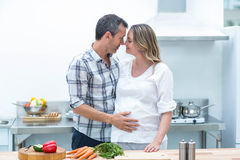 Man face to face with pregnant woman Royalty Free Stock Photo